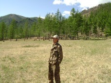A man guards and protects the mountain and the surrounding area. He said that he regrets that people cut trees to make profits, thereby polluting the environment.