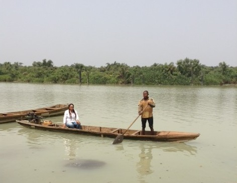 On a canoe ride to areas devastated by floods. Photograph: Daisy Onyige.