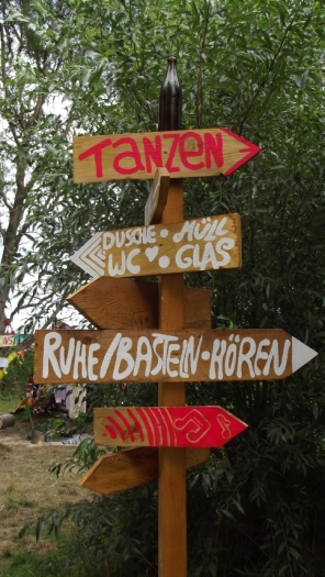 Sign indicating different festival areas. Photograph: Adrian Franco.