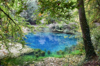 The Blautopf in Blaubeuren (Baden-Württemberg). The blue color is the result of light scattering at the nanoscale limestone particles densely distributed in the water.