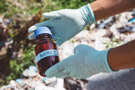 """From the field to the laboratory. Collecting samples, called """"slurries,"""" from an illegal waste site in Brandenburg, Germany."""